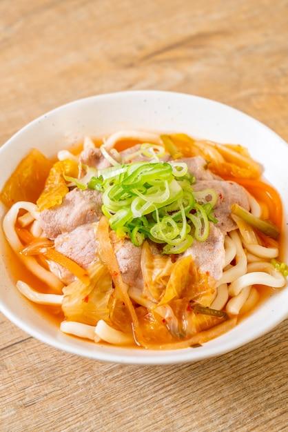 Udon ramen noodle with pork and kimchi Premium Photo