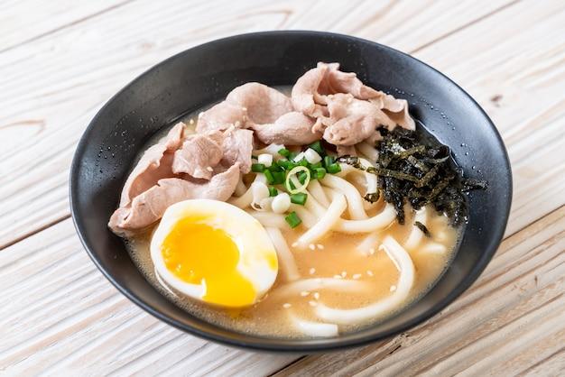 Udon ramen noodles with pork soup Premium Photo