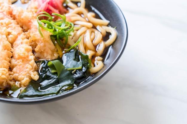 Udon ramen noodles with shrimps tempura Premium Photo