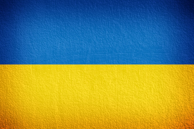 Ukraine flag on the wall texture Premium Photo