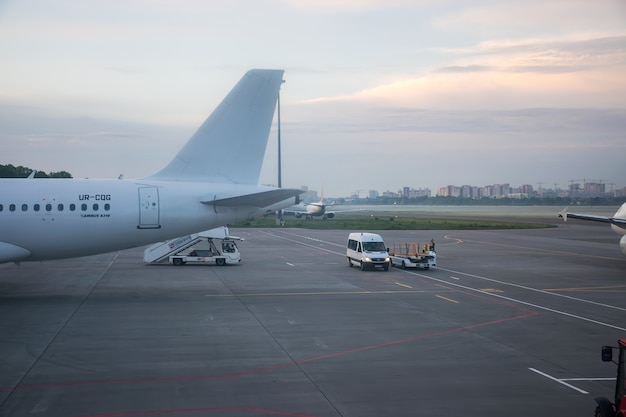 Ukraine, kiev, zhulyany airport. the operating personnel are preparing aircraft before departure. Premium Photo