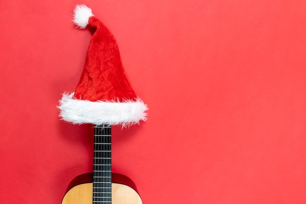 Ukulele wearing a santa claus hat Premium Photo