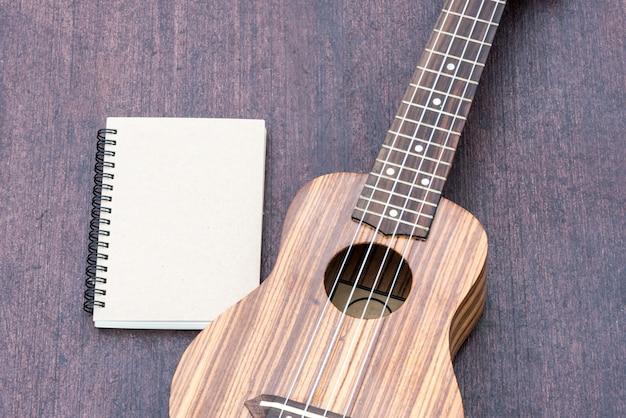 Ukulele with the notebook Free Photo