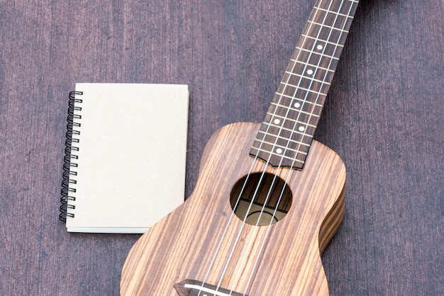 ukulele with the notebook Free Photo