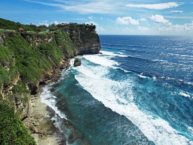 Uluwatu temple with ocean and cliff view with clear sky in bali, indonesia. Premium Photo