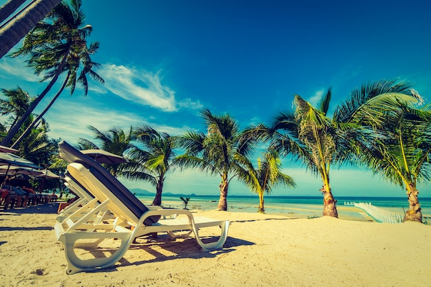 Umbrella and chair around beach and sea for travel and vacation Free Photo