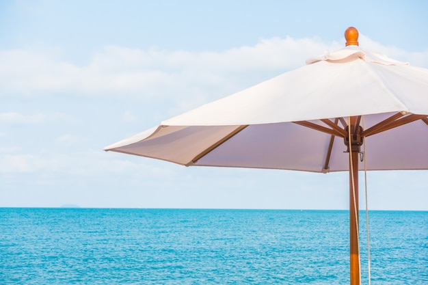 Umbrella and chair on the tropical beautiful beach Free Photo