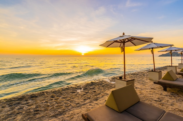 Umbrella and chair with pillow around beautiful landscape of beach and sea Free Photo
