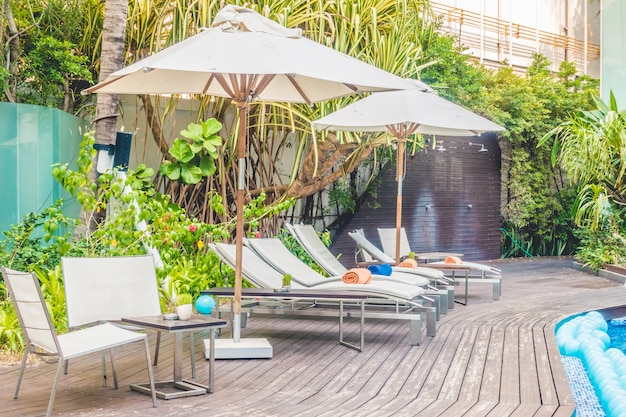 Umbrella pool and chair Free Photo
