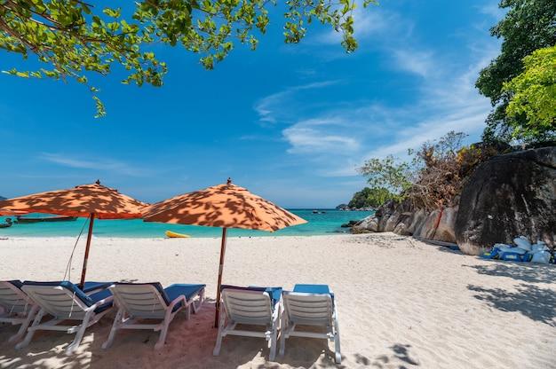 Umbrella with sunbed on the white beach in tropical sea Premium Photo