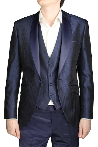 Unbuttoned night blue men wedding dress with a vest and a white shirt no tie, isolated on a white background. Premium Photo