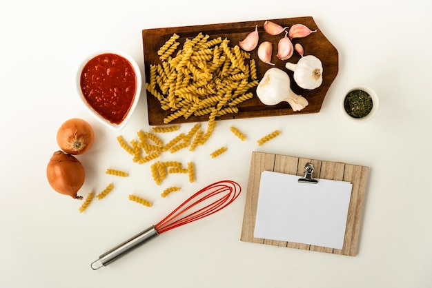 Uncooked fusilli pasta and healthy ingredient for making pasta Free Photo