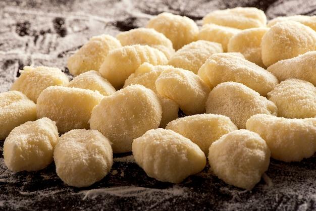 Uncooked italian semolina dumplings Premium Photo