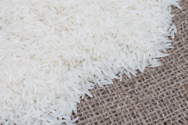 Uncooked white rice (jasmine rice)on brown sack. Premium Photo