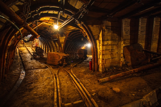 Underground mining tunnel with rails Premium Photo