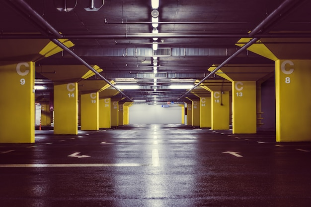 Underground parking garage at night Premium Photo