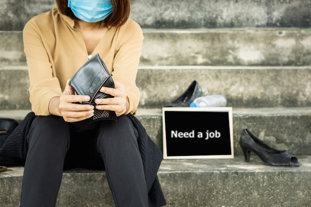 Unemployed asian business woman job loss during covid-19 crisis Premium Photo