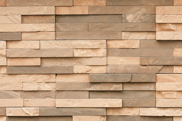 Uneven sandstone tile for wall surface Free Photo