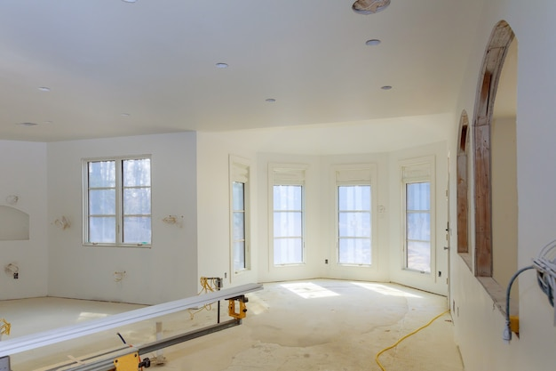 Unfinished apartment interior sheetrock in new home construction Premium Photo