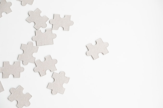 Premium Photo Unfinished White Jigsaw Puzzle Pieces On White Background