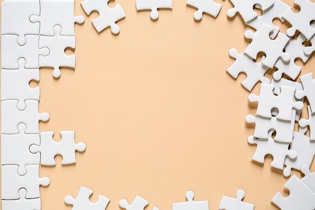 Unfinished white jigsaw Free Photo