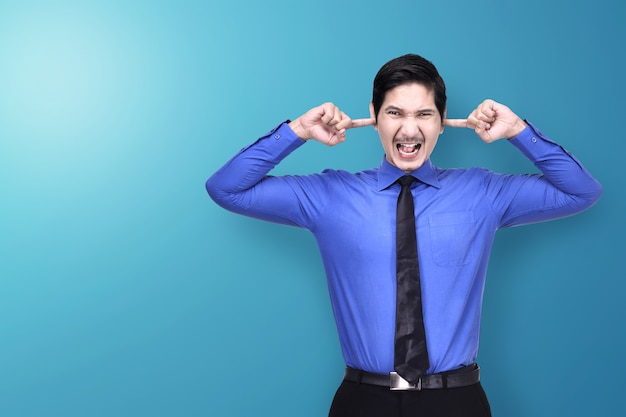 Unhappy asian businessman covering his ears with hand Premium Photo