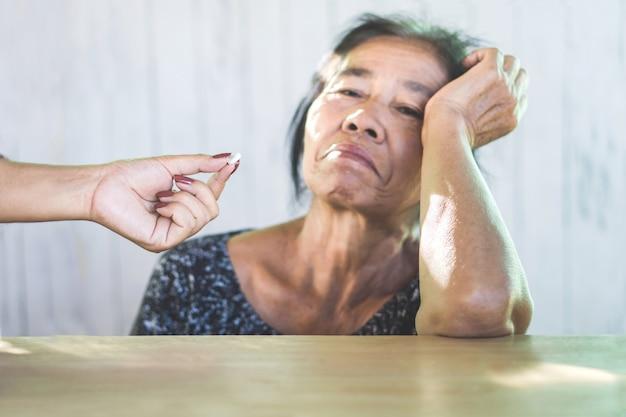 Unhappy asian mother refuse taking medicines Premium Photo