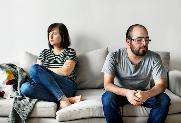 Unhappy couple arguing on the sofa Premium Photo