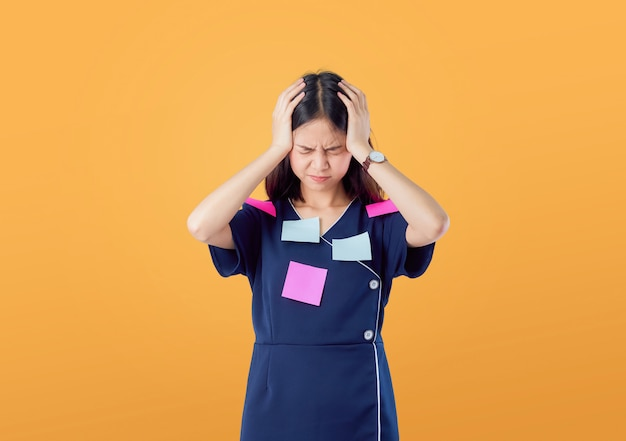 Unhappy young asian woman standing with holding hair and feeling confused with something Premium Photo