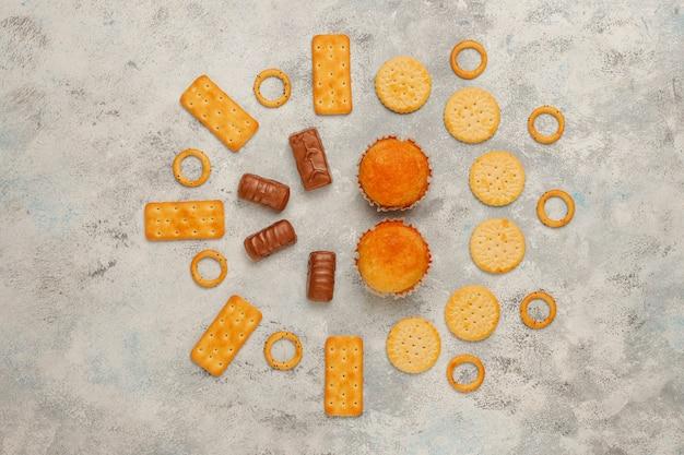 Unhealthy snacks on grey concrete Free Photo