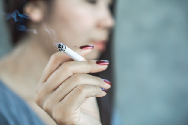Unhealthy woman smoking cigarette Premium Photo