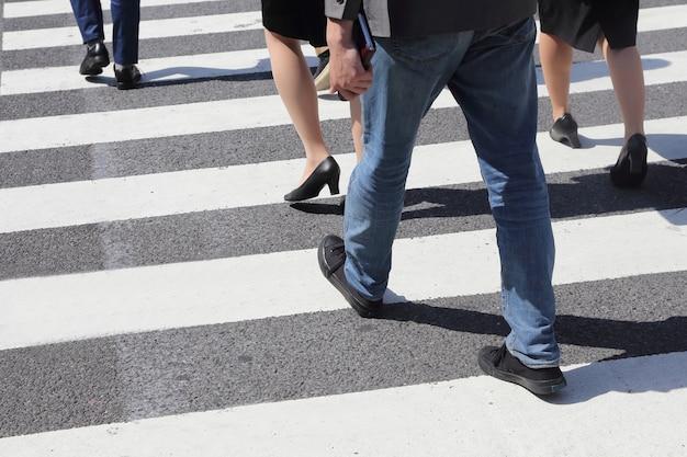 Unidentified people legs crossing street Premium Photo
