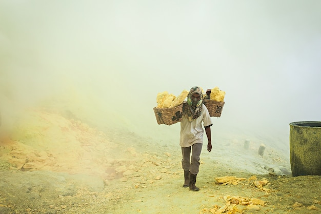 Unidentified sulfur miners Premium Photo