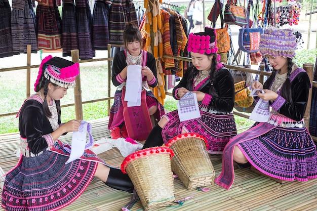 Unidentified traditional of thai weman (mhong girls)  sewing cloth at bangkok, thailand Premium Photo