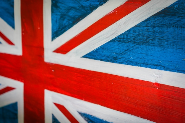 United kingdom flag painted on aged wooden wall . Free Photo