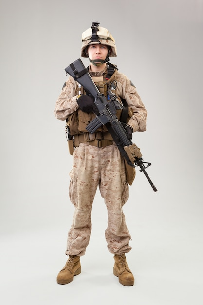 United states marine corps special operations command  raider with weapon. studio shot Premium Photo
