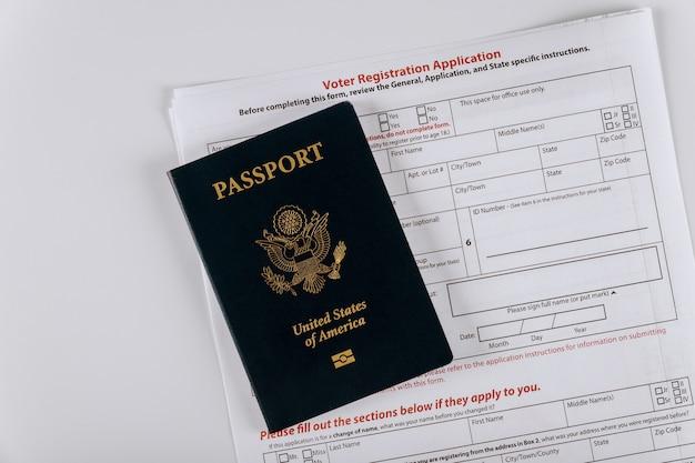 Premium Photo | United states voter registration application with united  states passport