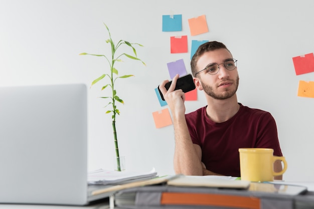 University student listening to his recorded notes Free Photo