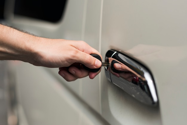 Unlocking a car door with a key Photo | Free Download