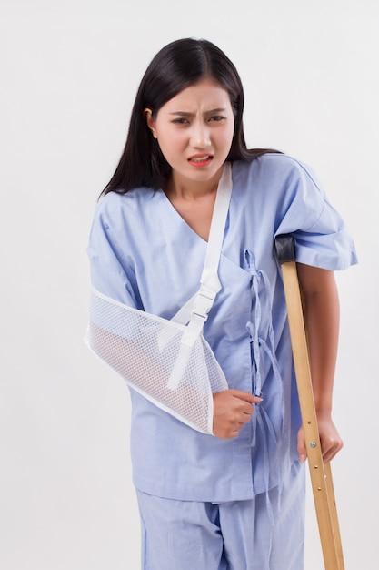 Unlucky woman with broken arm bone Premium Photo