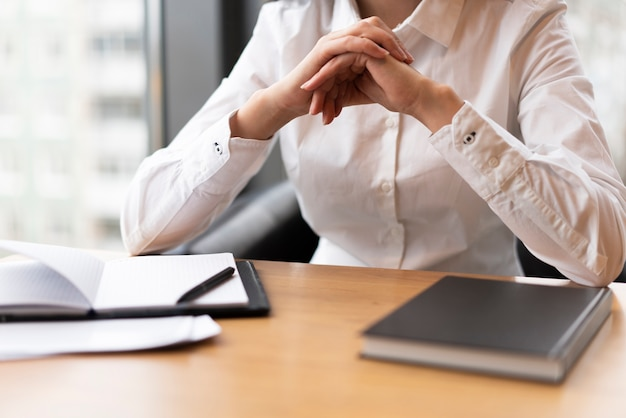 Unrecognisable woman thinking in office Free Photo