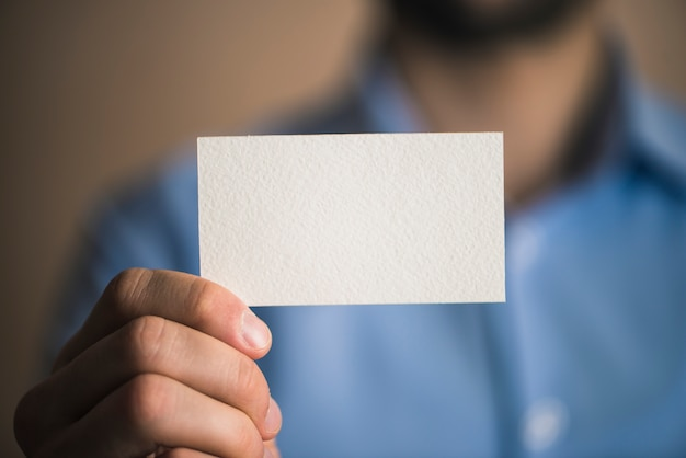 Unrecognizable businessman with card Free Photo