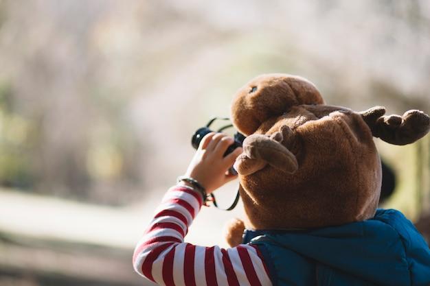 Unrecognizable child using binoculars Free Photo