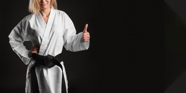 Unrecognizable fighter showing thumbs up Free Photo
