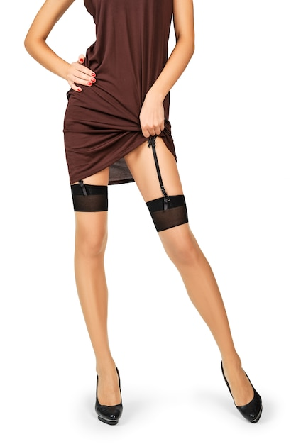 Unrecognizable lady lifting dress and showing stockings and garter Premium Photo