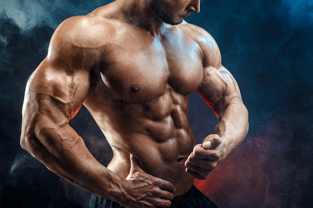 Unrecognizable strong bodybuilder man with perfect abs, shoulders,biceps, triceps, chest Premium Pho