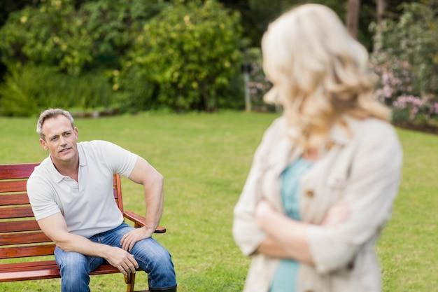 Upset couple having an argument in the garden Premium Photo
