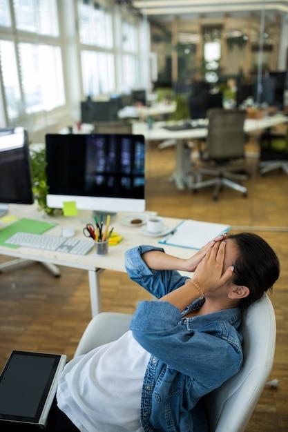 Upset female graphic designer in office Free Photo