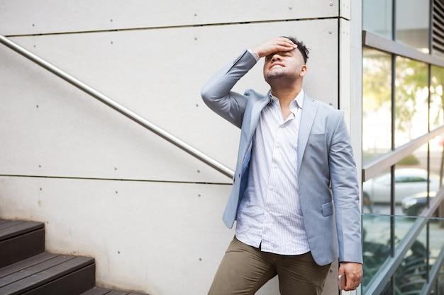 Upset hispanic businessman thinking of problems Free Photo