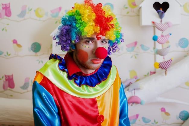 Upset lonely clown. Premium Photo